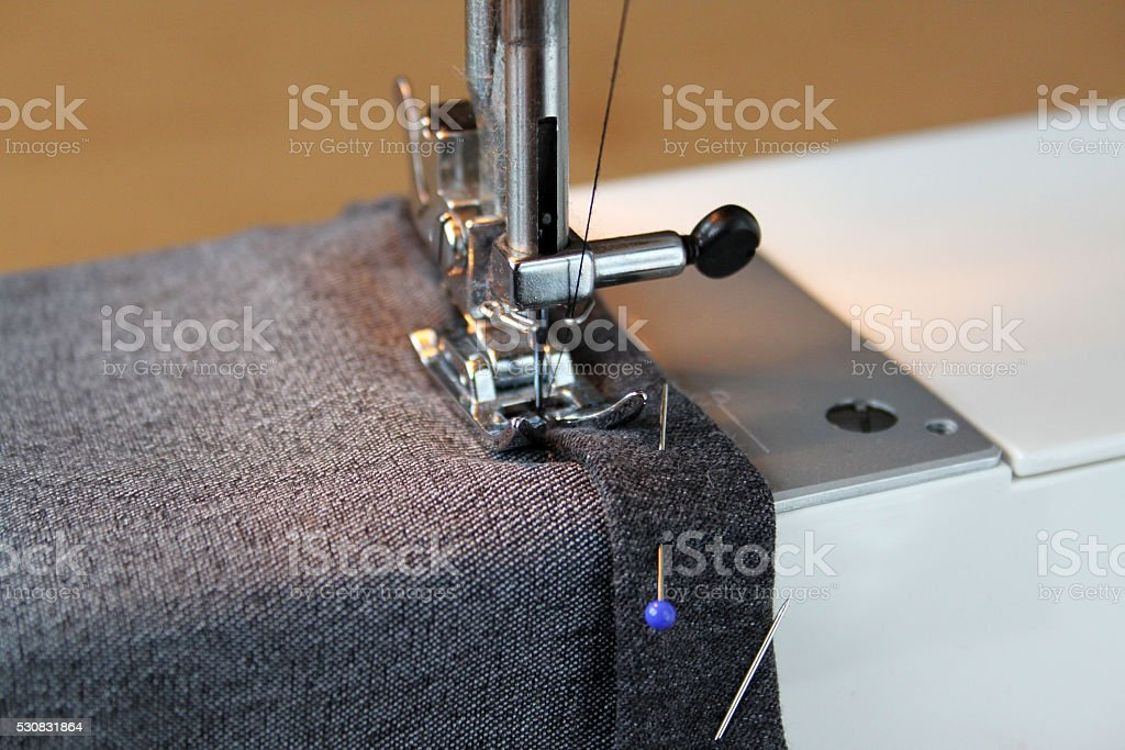 Home sewing machine in shortening pants stock photo