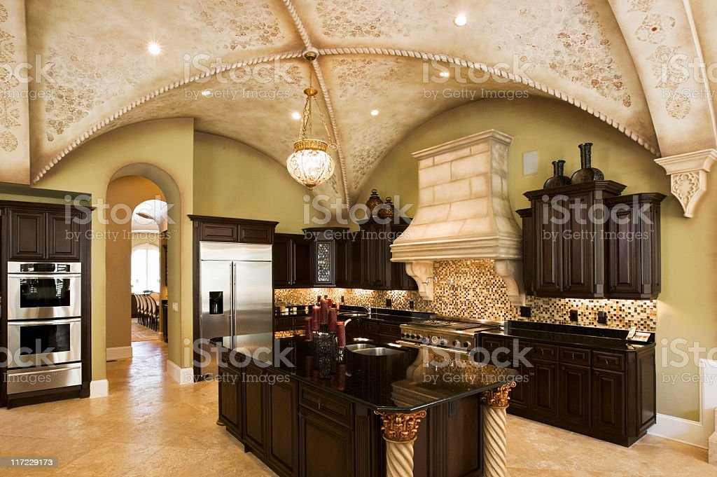 Kitchen with vaulted ceiling. Horizontal shot.
