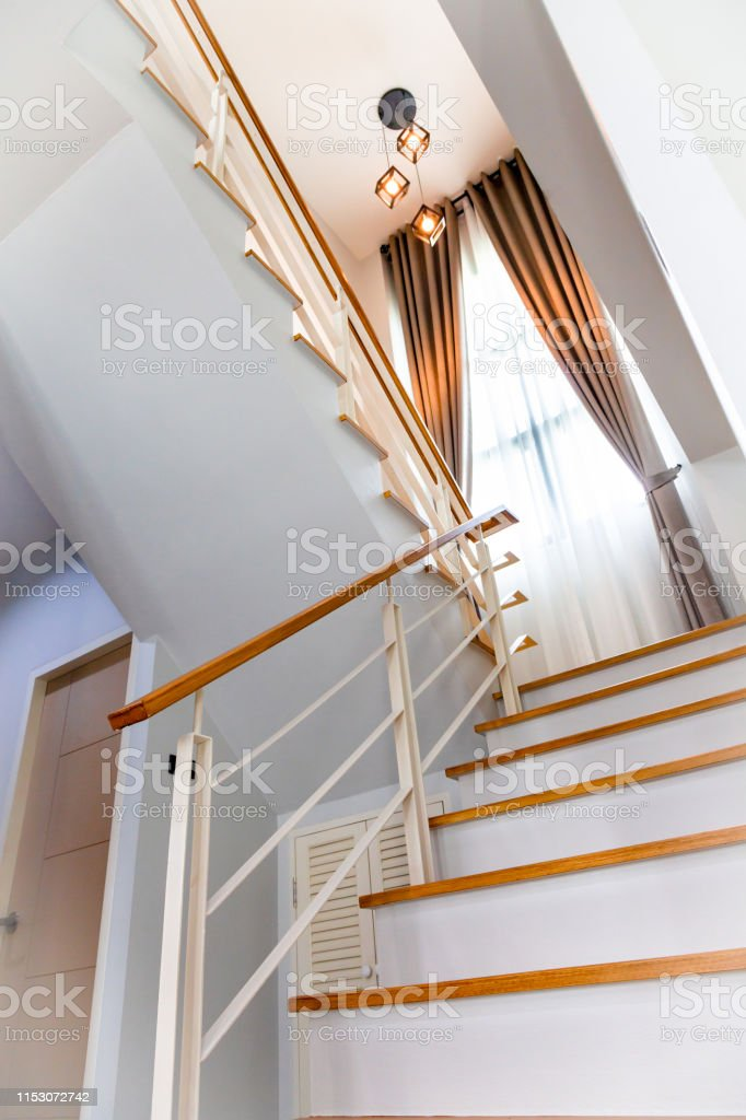 Home stairs way with wood inside contemporary interior.