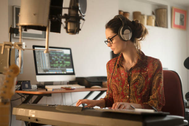 home studio player woman - musicians singers during lockdown foto e immagini stock