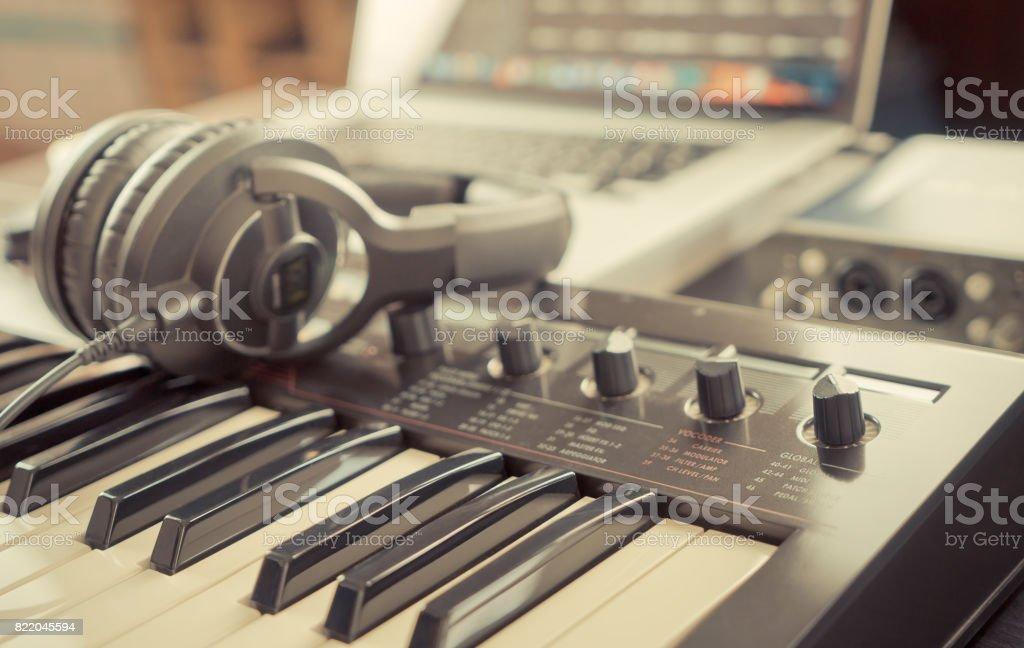Home studio working desk with keyboard and headphone stock photo