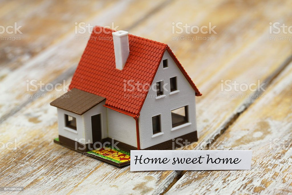 Home sweet home card with miniature model of a house Lizenzfreies stock-foto