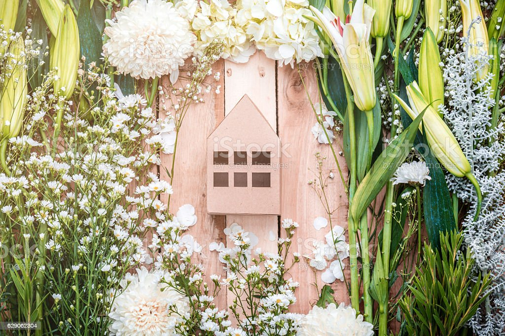 home sweet home concept with house model with flower stock photo