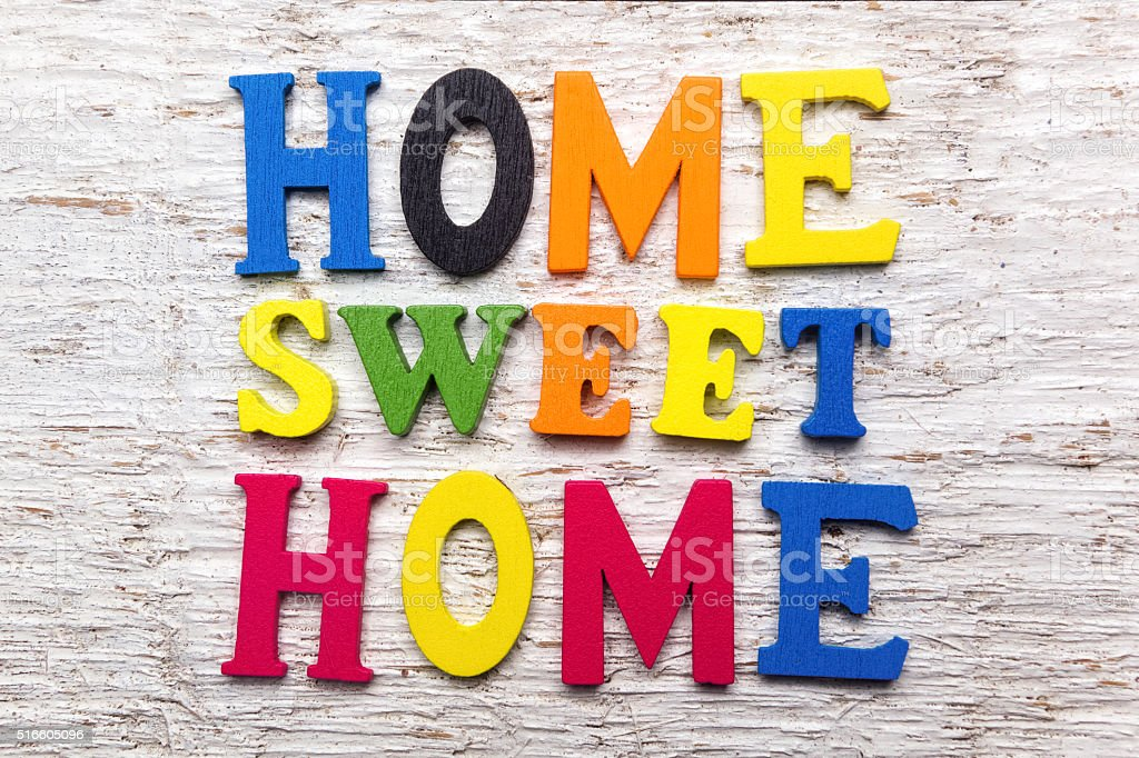 'Home Sweet Home' message wooden sign stock photo