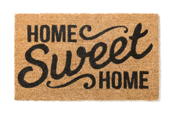 home sweet home welcome mat isolated on white - home sweet home imagens e fotografias de stock