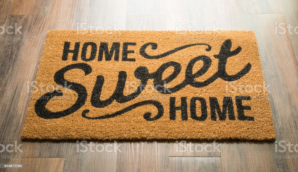 Home Sweet Home Welcome Mat On Floor stock photo