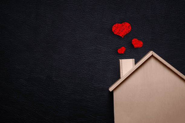 home sweet home with red heart. wooden house and black leather background. happy family lifestyles and loving people concept. future asset between us theme. wedding ceremony and engagement theme. - home sweet home imagens e fotografias de stock