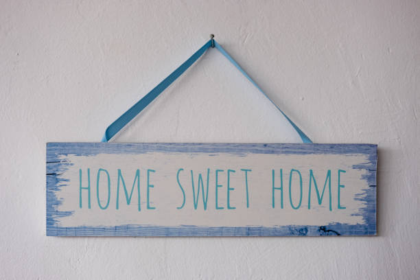Home sweet home, wooden text on vintage board background stock photo