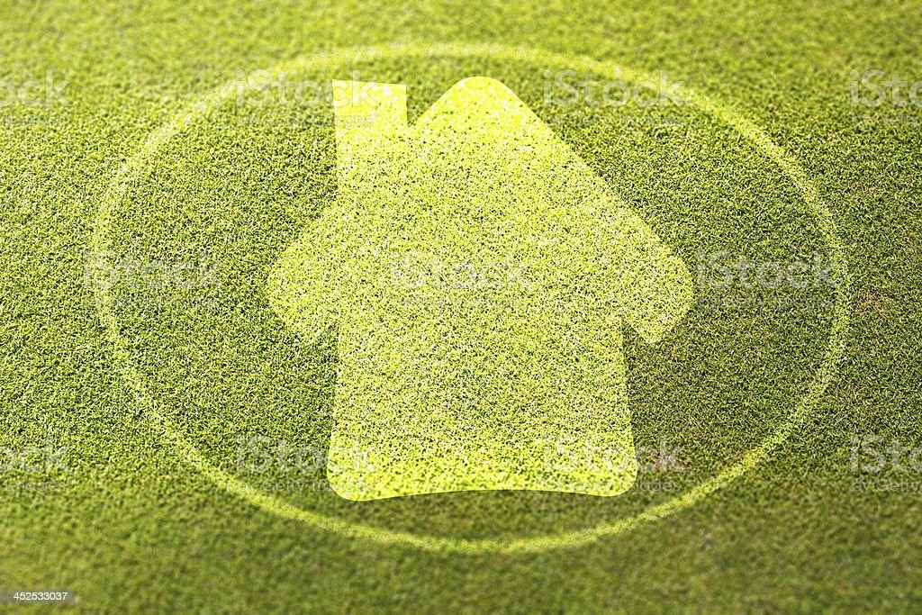 Home symbol on green grass poster illustration of eco-friendly house royalty-free stock photo