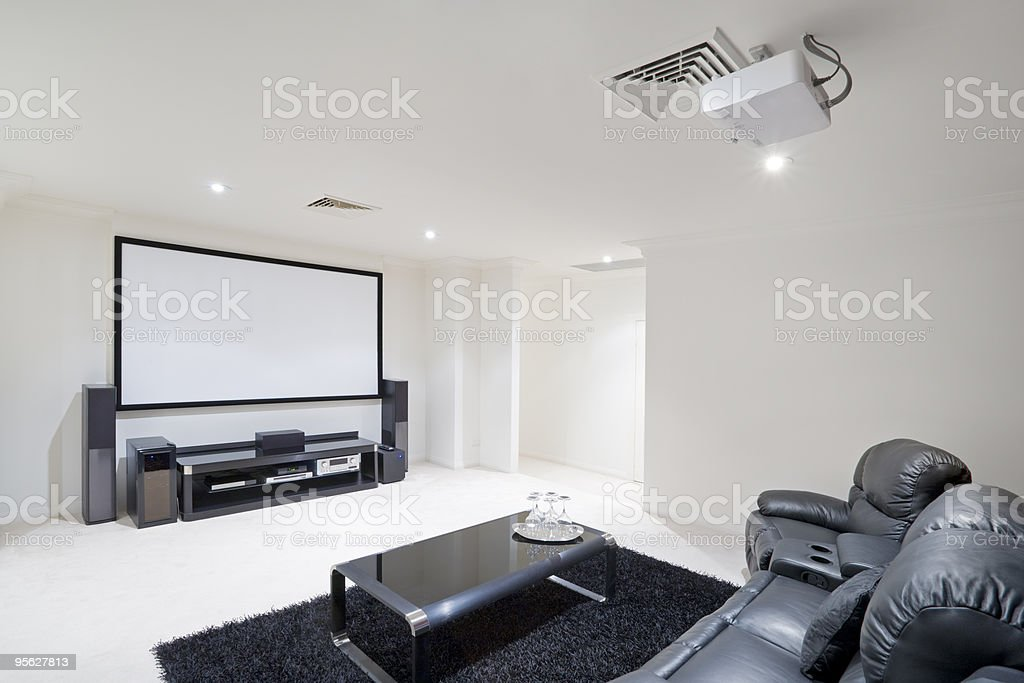 Home Theater Room with black leather recliner chairs stock photo