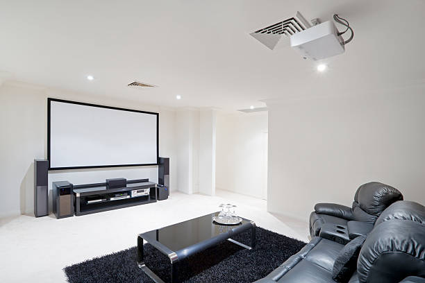 home theater room with black leather recliner chairs - projection equipment stock pictures, royalty-free photos & images