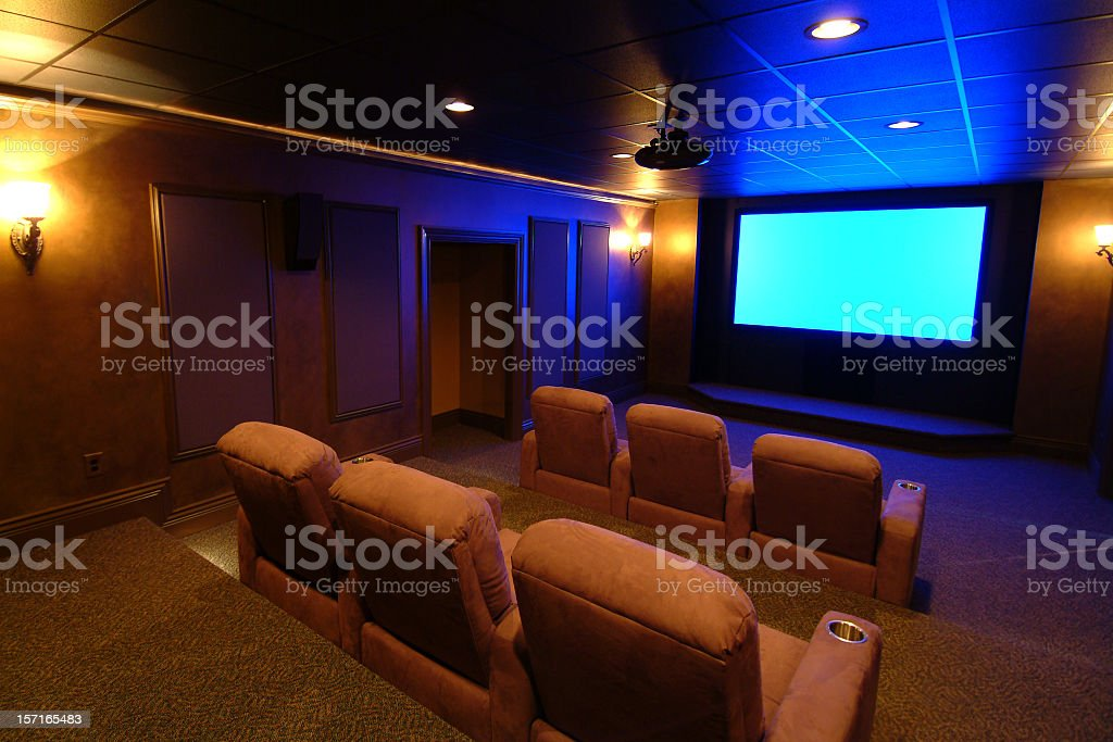 Home theater room with blue screen royalty-free stock photo