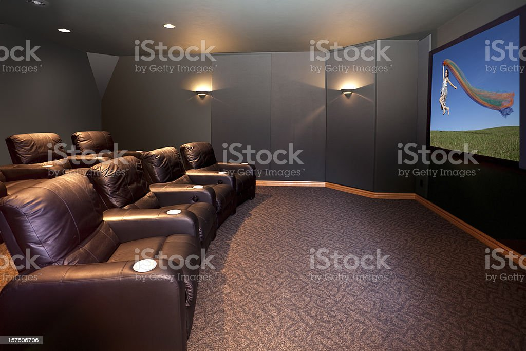 Home Theater Room With Leather Recliners stock photo