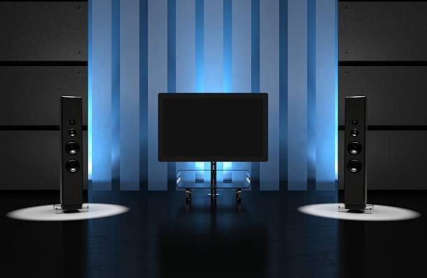 A home theatre in a darkened room stock photo