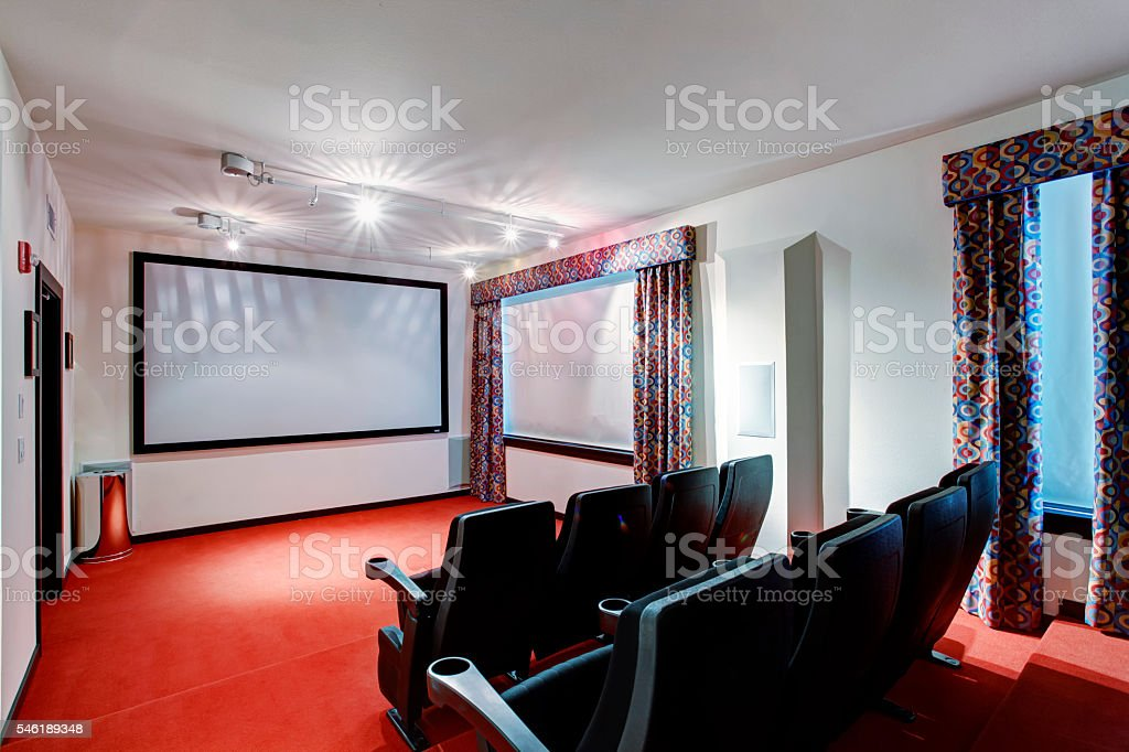 Home TV movie theater entertainment room interior stock photo