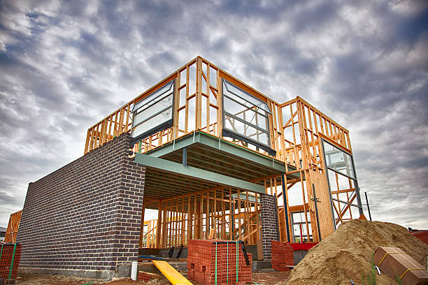 home under construction - construction material stock photos and pictures