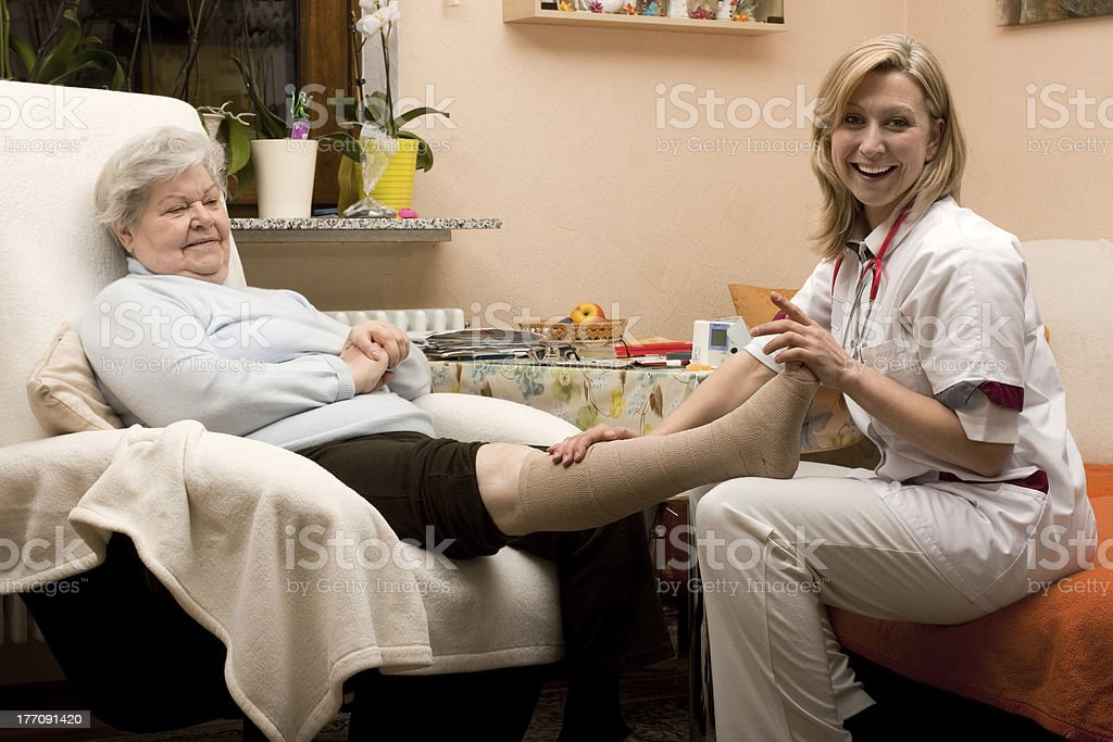 home visit doctor with senior stock photo