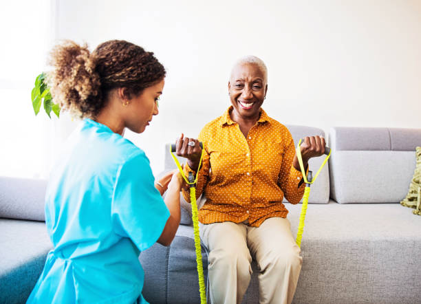 Home Visit - Nurse and her  Patient stock photo