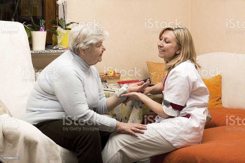 home visit nurse with senior stock photo