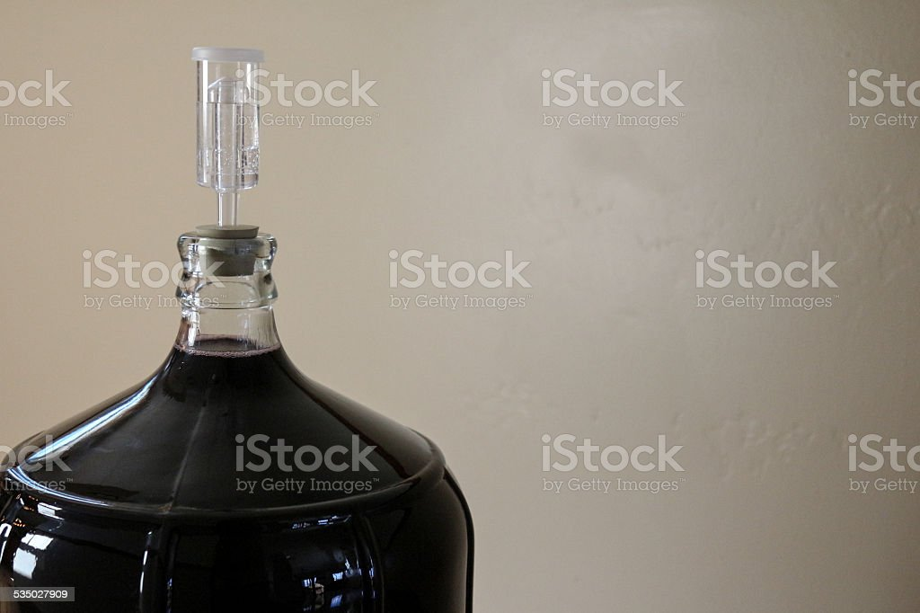 Home wine making airlock and carboy stock photo