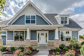 istock Home with blue siding and stone façade on base of home 1272128530