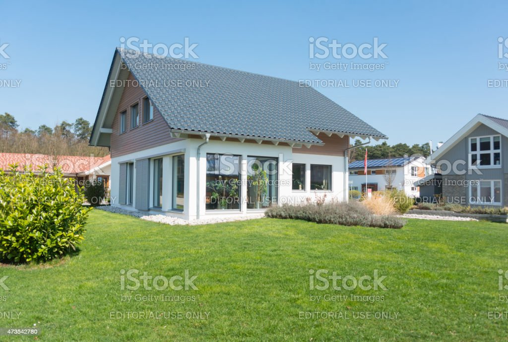 home with garden meadow stock photo