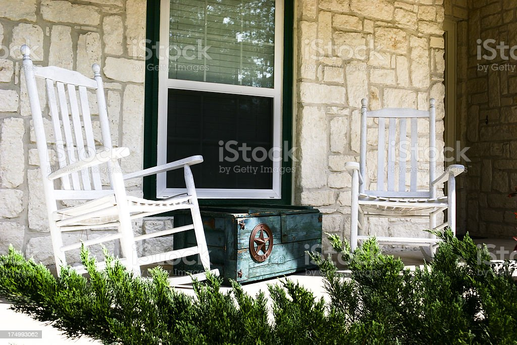 Home with rocking chairs and wooden box on porch stock photo