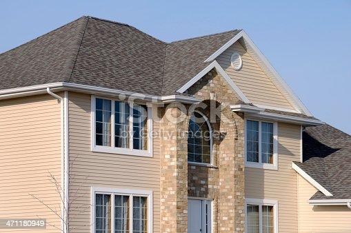 istock Home With Vinyl Siding, Brick Facade,  Architectural Asphalt Shingle Roof 471180949