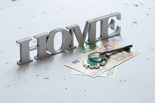 Home word with key and banknotes stock photo