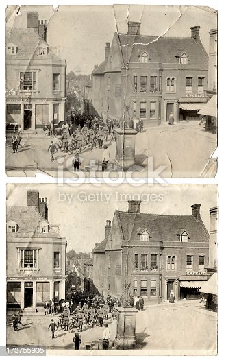 Vintage photograph showing British Troops marching through a English town.   Returning home from the war in Sudan in either the 1880s or 1890s.   The military band is playing and some of the troops have bicycles.   There are two versions the orginal badly damaged photo and a restored version.