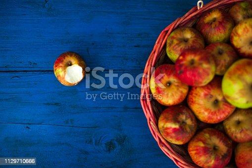 Homegrown Organic Bitten Apple on Table .