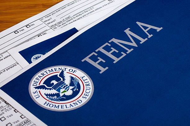 FEMA US Homeland Security Form FEMA US Homeland Security Citizen and Immigration Services Flyer Closeup department of homeland security stock pictures, royalty-free photos & images