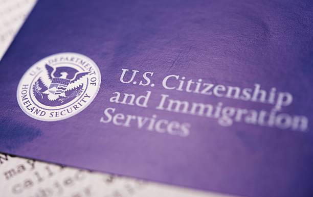 US Homeland Security US Homeland Security Citizen and Immigration Services Flyer Closeup. department of homeland security stock pictures, royalty-free photos & images