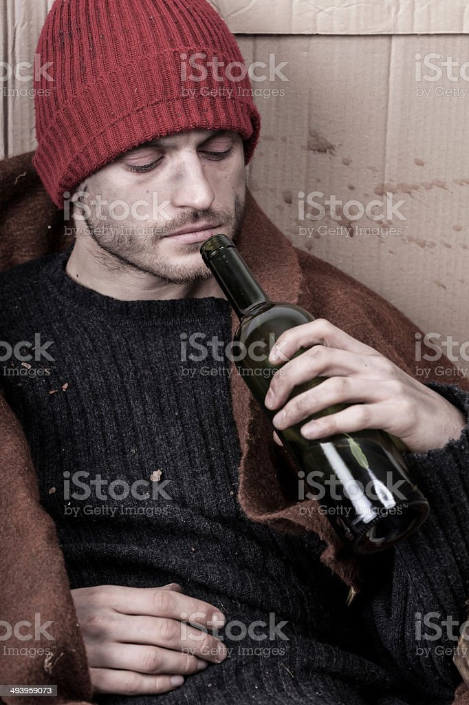 Homeless addicted to alcohol royalty-free stock photo