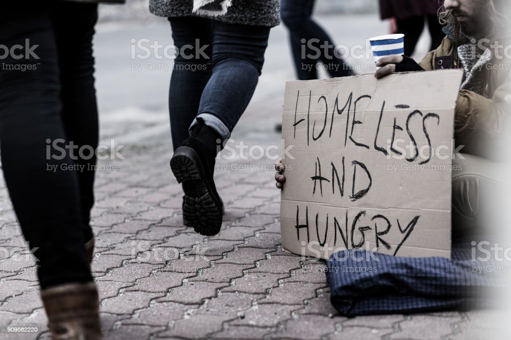 Homeless and hungry pauper stock photo