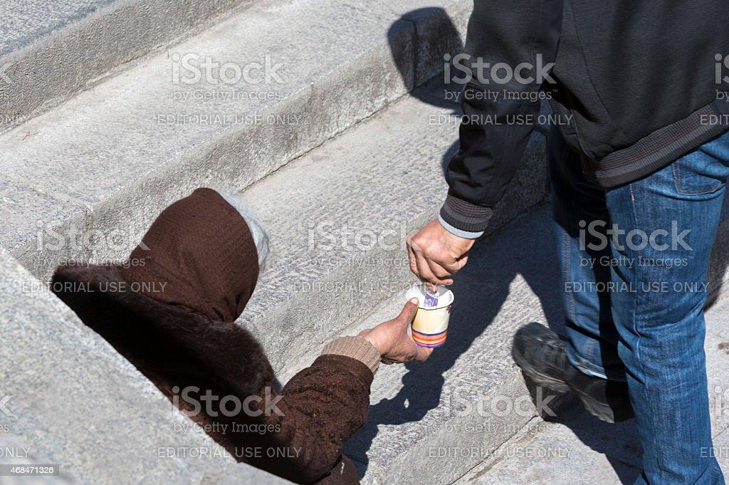 Homeless beggar giving money stock photo
