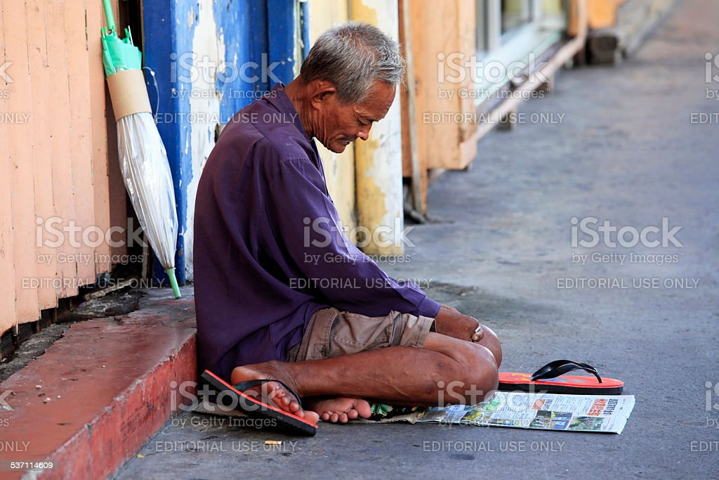 Homeless begger begging stock photo