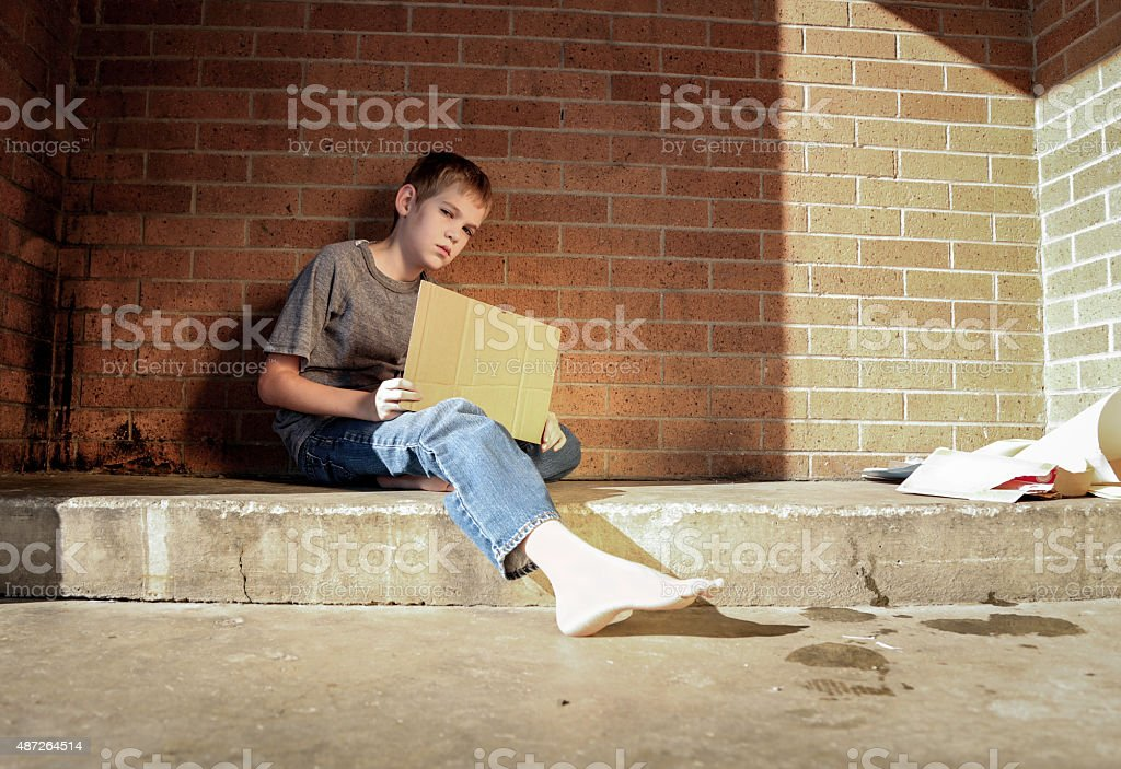 Homeless boy stock photo