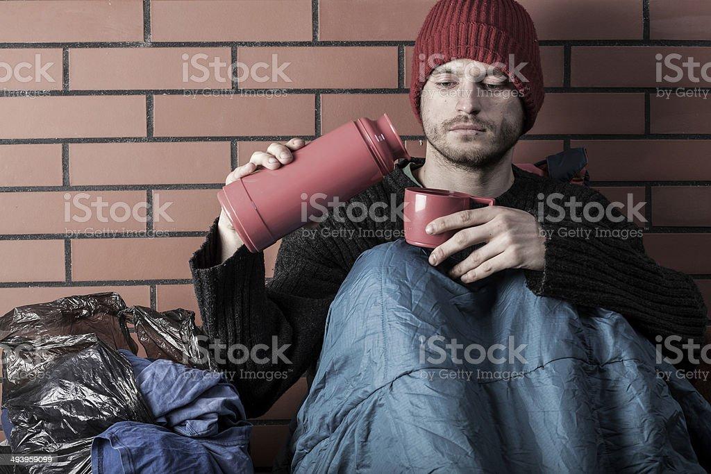 Homeless drinking hot tea royalty-free stock photo