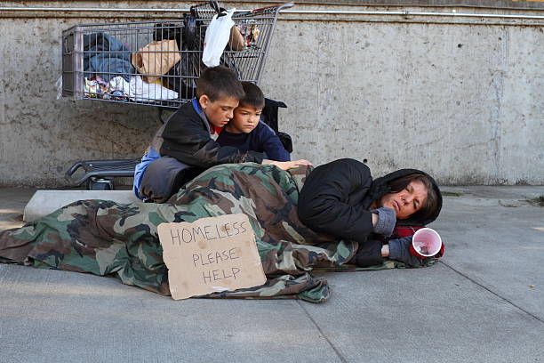 homeless family mom sick - homelessness stock photos and pictures