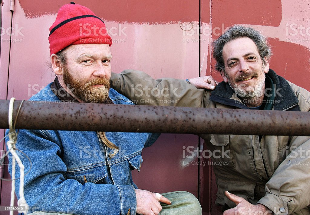 Homeless Friends Giving Side Hug royalty-free stock photo