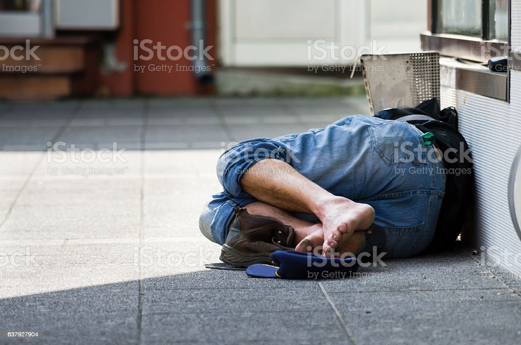 Homeless. Homeless man sleeps on the street stock photo