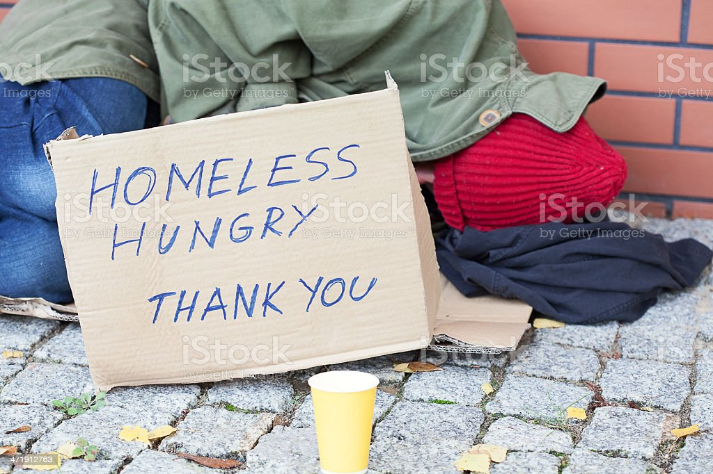 Homeless hungry poor man stock photo