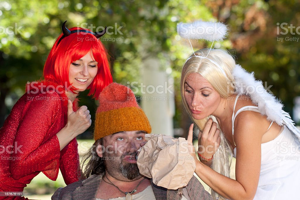 Homeless in Conflict With Angel And Devil, Italypse 2010 stock photo
