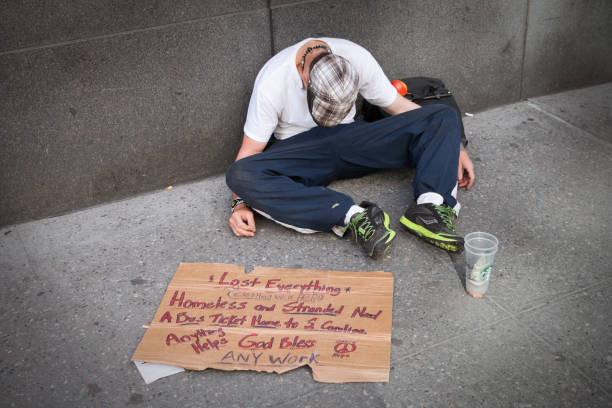 homeless in new york - man face down stock pictures, royalty-free photos & images