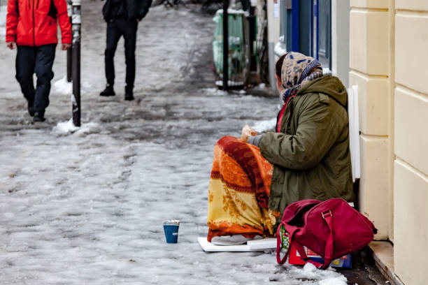 Homeless in Paris on snow covered street stock photo