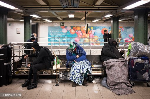 New York City, NY - March 22, 2017: Unidentified New York homeless people sleeping in the subway station in Manhattan, New York City