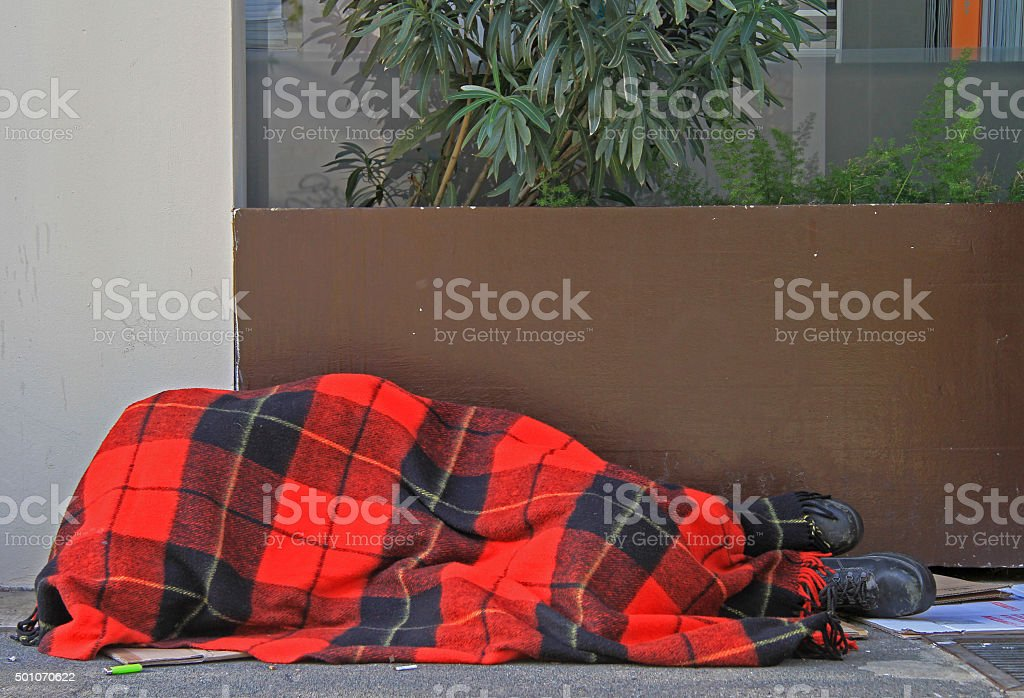 homeless is sleeping outdoor in Milan, Italy stock photo