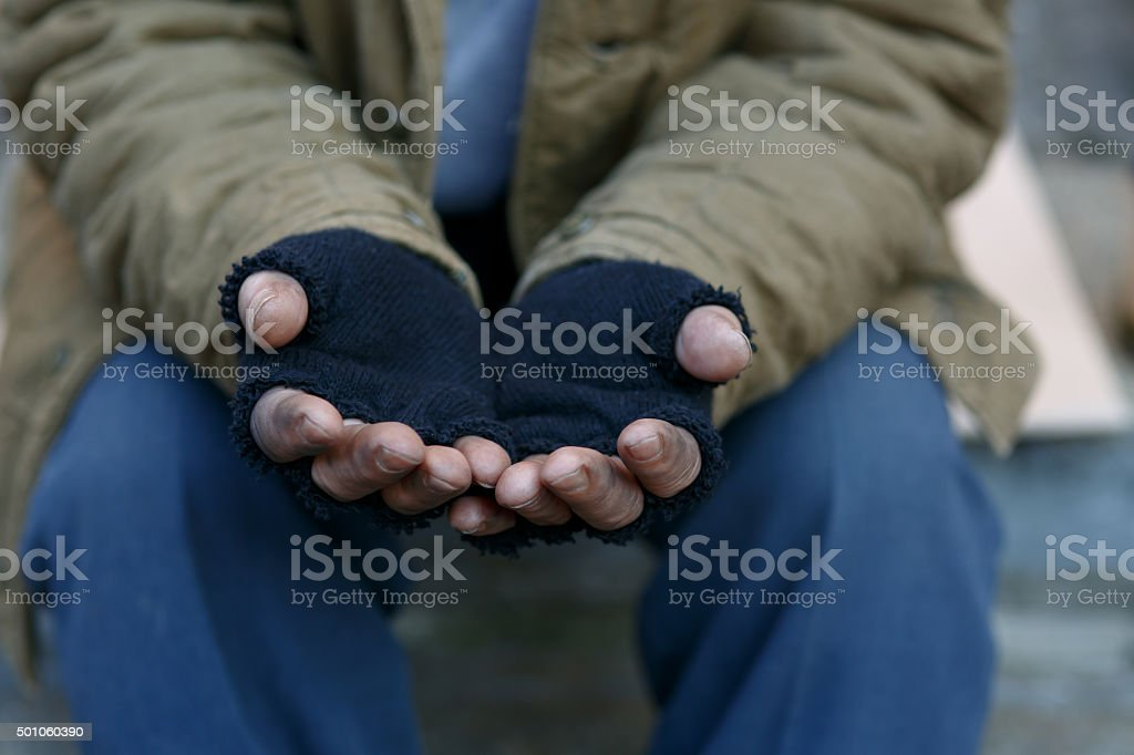 Homeless man asking for help stock photo