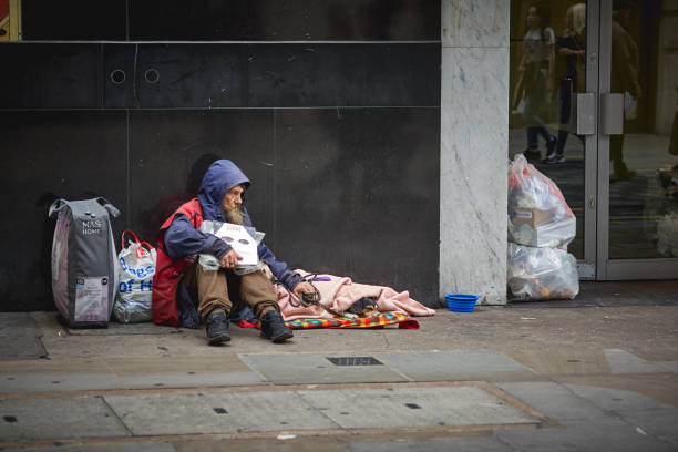 A homeless man begging for help in central London. London, UK - August, 2018. A homeless man begging for help in central London. central london stock pictures, royalty-free photos & images